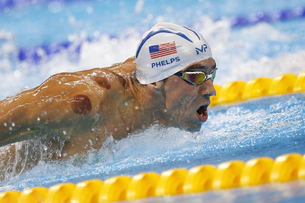 epa05465097 Michael Phelps of the USA competes in the Men's 200m Butterfly Heats of the Rio 2016 Olympic Games Swimming events at Olympic Aquatics Stadium in Rio de Janeiro, Brazil, 08 August 2016.  EPA/PATRICK B. KRAEMER