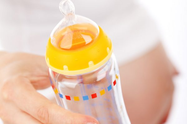mother-with-a-feeding-bottle