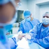 surgeons-performing-operation-in-operation-room_1170-2244-1-600x400